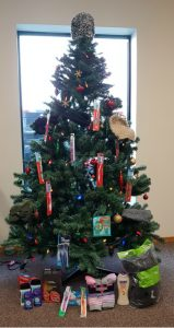 Our Christmas tree with a few warm items around it