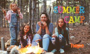 Kids enjoying a camp fire.
